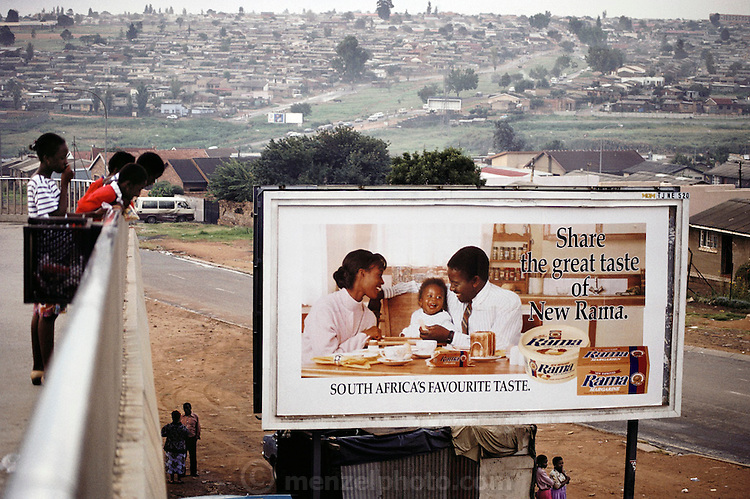 Roadside advertisement for Rama butter spread on an overpass at the minibus station in Soweto, South Africa. Material World Project.
