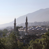 Grand Mosque or Ulu Cami, built 1396-99 under the Ottoman Sultan Bayezid I by the architect Ali Neccar in the Seljuk style, Bursa, Turkey. It is a large rectangular building with 2 minarets, and 20 domes supported by 12 columns. Supposedly the 20 domes were built instead of the 20 separate mosques which Sultan Bayezid I had promised for winning the Battle of Nicopolis in 1396. The mosque is in the old city centre of Bursa and remains the largest mosque in the city. Picture by Manuel Cohen