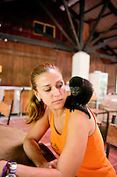 Vanessa Lizano with a baby howler monkey at her Costa Rica Wildlife Sanctuary run by Vanessa and her family. Moin, Limon, Costa Rica.