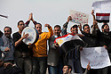 """Egyptians beat drums and chant anti-government slogans during a  """"million man march"""" demonstration February 01, 2011 in Central Cairo's Tahrir, or """"Liberation"""" square. The march capped a week of protests that are threatening to bring down the nearly 30 year old regime of Hosni Mubarak."""