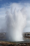 Strokkur Geyser erupts every 4-8 minutes, sometimes up to 40 metres high. Here tourists watch in awe as it explodes.