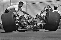 """""""Rolling chassis"""" in the garage area at the 1977 Indianapolis 500."""