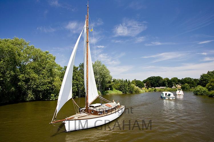 Sailing boat and motor cruisers on the Norfolk Broads, United Kingdom