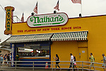 Brooklyn, New York, USA. 10th August 2013. People walk to the baordwalk by Nathan's Famous,  during the 3rd Annual Coney Island History Day celebration.