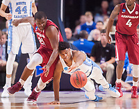 NWA Democrat-Gazette/J.T. WAMPLER Arkansas' Manuale Watkins and North Carolina's Isaiah Hicks vie for the ball Sunday March 19, 2017 during the second round of the NCAA Tournament at the Bon Secours Wellness Arena in Greenville, South Carolina. The Tar Heels beat the Razorbacks 72-65 eliminating them from the tournament.