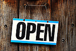 Open sign on the door of a wine shop located in aan old barn in Connecticut, USA.