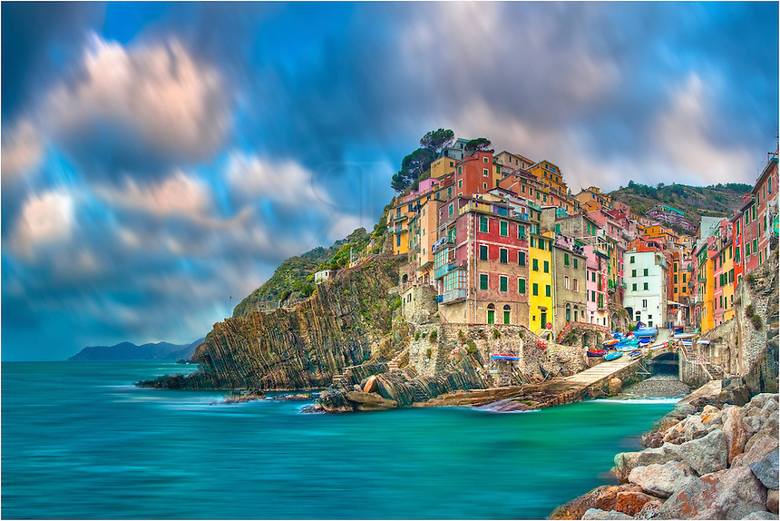 I had the harbor all to myself this morning. Watching the waves roll into the stones of Riomaggoire Italy, I couldn't help think what life is like in this sleep village in the Cinque Terre.