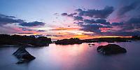 A colorful sunset at Salt Pond in Hanapepe, Kauai