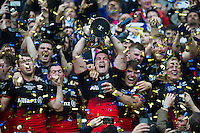 Brad Barritt of Saracens lifts the European Rugby Champions Cup trophy as his team-mates celebrate. European Rugby Champions Cup Final, between Saracens and Racing 92 on May 14, 2016 at the Grand Stade de Lyon in Lyon, France. Photo by: Patrick Khachfe / Onside Images