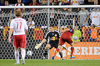 Fabian Espindola (7) of Real Salt Lake shoots and scores on New York Red Bulls goalkeeper Frank Rost (1) during a Major League Soccer (MLS) match at Red Bull Arena in Harrison, NJ, on September 21, 2011.
