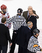 Joe Pereira (BU - 6), Albie O'Connell (Northeastern - Assistant Coach), Bob Bernard, Jack Parker (BU - Head Coach), Greg Cronin (Northeastern - Head Coach), Mike Geragosian (BU - Assistant Coach), Tim Benedetto - The visiting Northeastern University Huskies defeated the Boston University Terriers 5-4 on Sunday, March 13, 2011, to win their Hockey East Quarterfinal matchup 2 games to 1 at Agganis Arena in Boston, Massachusetts.