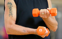NWA Democrat-Gazette/DAVID GOTTSCHALK - The hands of Bob Thomas are visible as he lifts weights while participating in the Young at Heart fitness class at the Fayetteville Athletic Club Monday, July13 , 2015 under the direction of personal trainer Reuben Reina.