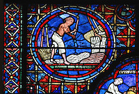 A bare-chested sun-tanned peasant threshes the wheat, section of August from the Zodiac and the labours of the months stained glass window, 1217, in the ambulatory of Chartres Cathedral, Eure-et-Loir, France. This calendar window contains scenes showing the zodiacal symbol with its corresponding monthly activity. Chartres cathedral was built 1194-1250 and is a fine example of Gothic architecture. Most of its windows date from 1205-40 although a few earlier 12th century examples are also intact. It was declared a UNESCO World Heritage Site in 1979. Picture by Manuel Cohen