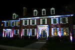 "04/02/2012 - Medford/Somerville, Mass. -  Tufts University President Anthony P. Monaco lights Gifford House in support of the ""Light It Up Blue""  national autism awareness campaign on Monday, April 2, 2012.  (Alonso Nichols/Tufts University)"