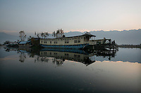 Dal Lake, famed for its ornately-carved cedar houseboats, is the centrepiece of Srinagar?s tourist trade. But in the past two decades it has shrunk by more than half to 11 square kilometres and lost 12 meters in depth. Pollution is a big problem for the lake, in addition to the 7,500 people living on houseboats, another 50,000 people inhabit small islands in the area. Srinagar, Kashmir, India. © Fredrik Naumann/Felix Features