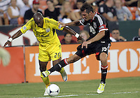 WASHINGTON, DC - AUGUST 4, 2012:  Emilliano Dudar (19) of DC United pushes Emilio Renteria (20) of the Columbus Crew during an MLS match at RFK Stadium in Washington DC on August 4. United won 1-0.