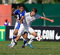 Marc Pelosi (10) of the United States fights for the ball with Jose Pena (9) of El Salvador during the quarterfinals of the CONCACAF Men's Under 17 Championship at Catherine Hall Stadium in Montego Bay, Jamaica. The USA defeated El Salvador, 3-2, in overtime.