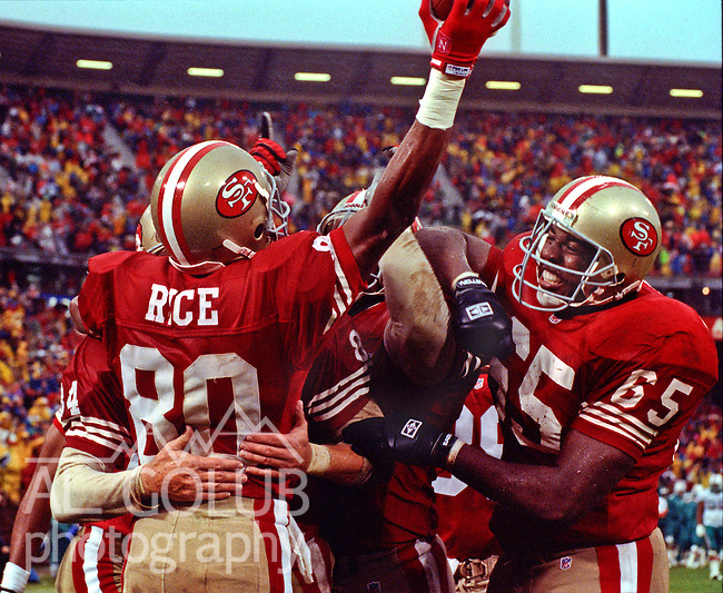 San Francisco 49ers vs. Miami Dolphins at Candlestick Park Sunday, December 6, 1992.  49ers Beat Dolphins 27-3.  San Francisco 49ers wide receiver Jerry Rice (80) celebrates touchdown with guard Harry Boatswain (65) and others.