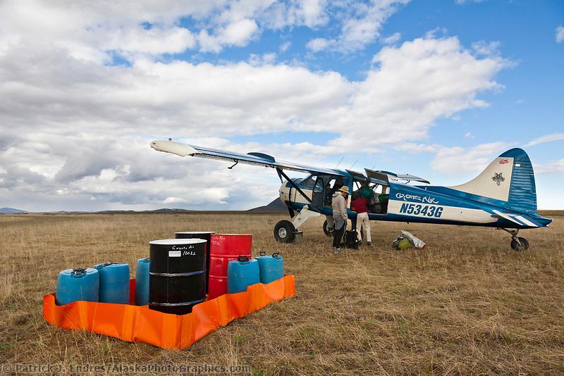Coyote Air de Havilland Beaver bush plane at a refueling stop in the arctic.