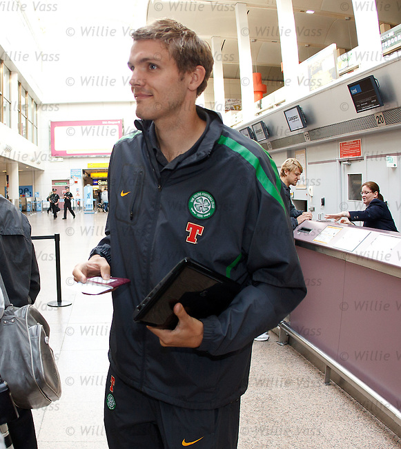 Jos Hooiveld returns back late to the airport after originally forgetting his passport for the trip to Holland