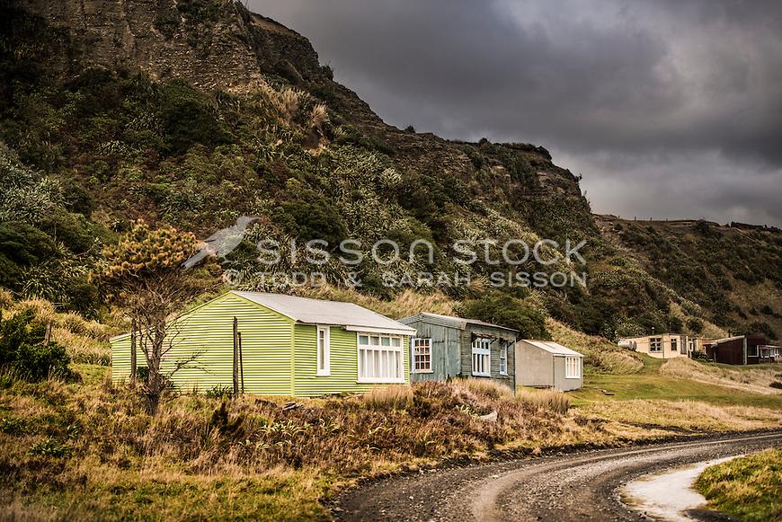 Old baches, Ocean Beach, Wairarapa Coast, New Zealand- stock photo, canvas, fine art print