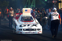 MADISON, IL - JUNE 25: John Force backs his Funny Car toward the starting line during the O'Reilly NHRA Midwest Nationals on June 25, 2006, at Gateway International Raceway near Madison, Illinois.