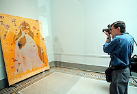 "A photographer photographs ""Virgin Mary"" by Chris Ofili at the Brooklyn Museum Sensdation show on September 30, 1999. (© Richard B. Levine)"