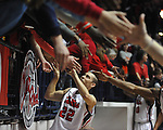 "Ole Miss' Marshall Henderson (22) celebrates with fans following vs. Auburn at the C.M. ""Tad"" Smith Coliseum on Saturday, February 23, 2013. Mississippi won 88-55. Henderson scored 28 and tied the school record with 8 three pointers."