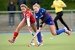 GER - Mannheim, Germany, April 22: During the German Hockey Bundesliga women match between Mannheimer HC (blue) and Club an der Alster (red) on April 22, 2017 at Am Neckarkanal in Mannheim, Germany. Final score 1-1 (HT 1-0).  Anne Schroeder #19 of Club an der Alster Camille Nobis #8 of Mannheimer HC<br /> <br /> Foto &copy; PIX-Sportfotos *** Foto ist honorarpflichtig! *** Auf Anfrage in hoeherer Qualitaet/Aufloesung. Belegexemplar erbeten. Veroeffentlichung ausschliesslich fuer journalistisch-publizistische Zwecke. For editorial use only.