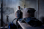 A worker without proper face protection works at a denim sandblasting plant outside of Dhaka, Bangladesh March 25, 2010. Manual sandblasting was recently banned in Turkey after it was discovered that it led to 40 deaths. Without the use of proper face protection, manual sandblasting can lead to silicosis by the inhalation of the silica dust in sand. Manual sandblasting has long been banned many European countries and the United States. The textile industry is Bangladesh's number one export earner and employs over 2.2 million workers.