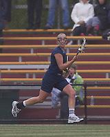 University of New Hampshire midfielder Ilana Cohen (9) brings the ball forward. Boston College defeated University of New Hampshire, 11-6, at Newton Campus Field, May 1, 2012.