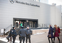 NYPD officers guard the fashionistas as they arrive in their finery outside of the Fall 2014 Fashion Week shows in Lincoln Center in New York, seen on opening day, Thursday, February 6, 2014. This year some designers are abandoning the tents at Lincoln Center to hold their shows at far flung venues, including Brooklyn.  (© Richard B. Levine)