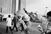 Moscow, Russia<br /> Soviet Union<br /> August 1991<br /> <br /> Just after a failed coupe on Soviet President Mikhail Gorbachev, people visit the Parliament build where the opposition to the coupe held out.<br /> <br /> In December 1991, food shortages in central Russia had prompted food rationing in the Moscow area for the first time since World War II. Amid steady collapse, Soviet President Gorbachev and his government continued to oppose rapid market reforms like Yavlinsky's &quot;500 Days&quot; program. To break Gorbachev's opposition, Yeltsin decided to disband the USSR in accordance with the Treaty of the Union of 1922 and thereby remove Gorbachev and the Soviet government from power. The step was also enthusiastically supported by the governments of Ukraine and Belarus, which were parties of the Treaty of 1922 along with Russia.<br /> <br /> On December 21, 1991, representatives of all member republics except Georgia signed the Alma-Ata Protocol, in which they confirmed the dissolution of the Union. That same day, all former-Soviet republics agreed to join the CIS, with the exception of the three Baltic States.