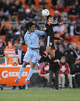 D.C. United midfielder Andy Najar (14) heads the ball against Sporting Kansas City midfielder Roger Espinoza (15) Sporting Kansas City defeated D.C. United  1-0 at RFK Stadium, Saturday March 10, 2012.