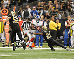 New Orleans Saints Patrick Robinson (21) vs. New York Giants D.J. Ware (28) at the Superdome in New Orleans, La. on Monday, November 28, 2011. New Orleans won 49-24.