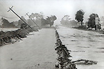 Road damage after Hurricane Elena churned in the Gulf of Mexico off the coast of the Florida panhandle in September 2, 1985.  Elena was the first major hurricane of the 1985 season and it's unusual path included a loop and went back and fourth along the Florida panhandle as a category 3 storm heavily damaging the Apalachicola, FL oyster industry.  Apalachicola recorded the highest surge and rainfall totals and whatever oyster industry wasn't ruined by Elena was finished off when Hurricane Kate followed  in November of the same season.