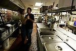 Mike Jones dances with friend Pam Pitts in the kitchen of The Lantern Inn, his family's restaurant, before he puts on a show as Elvis Presley on Saturday, Dec. 16, 2006. Jones rode on Anderson's school bus for many years, she said, adding &quot;he didn't use to cuss like he does now.&quot; Jones has been performing as Elvis at the eatery for 18 years, but Saturday was the curtain call. The Lantern Inn closed its doors on Sunday after more than 40 years of business.<br />