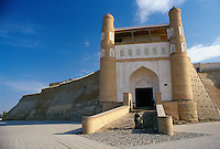 A man with a bicycle at the Ark Citadel  in Bukhara, Uzbekistan. It is a residence of the Bukhara Khans.