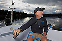 WA09110-00...WASHINGTON - Terry Donnelly sailing the waters off Vashon Island in the Puget Sound. (MR# D13)