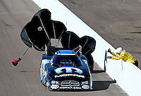 Feb. 23, 2013; Chandler, AZ, USA; NHRA Safety Safari member tries to get funny car driver Matt Hagan to stop during qualifying for the Arizona Nationals at Firebird International Raceway. Mandatory Credit: Mark J. Rebilas-
