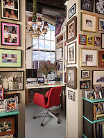 A vast collection of family photographs lines the walls of this cosy and space-saving home office