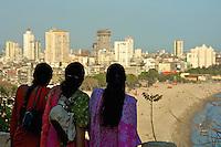 Indian women take in the view from Mumbai Garden overlooking the beach, Mumbai, India