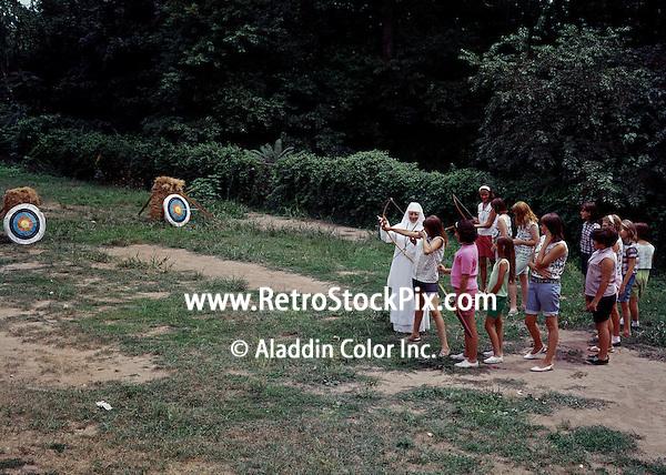 St. John Villa Academy. Children learning archery from a nun. 1959 - 161