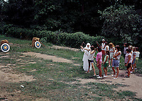 St. John Villa Academy. Children learning archery from a nun. 1959 - 161