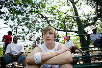 12 June 2006 - New York City, NY - Max von Helldorf (C), visiting New York City from Germany, watches players compete in the tryouts for the Ruckers street basketball tournament, at Ruckers Park in Harlem, New York City, USA, as he waits his turn to play, Sunday June 12 2005. Photo Credit: David Brabyn