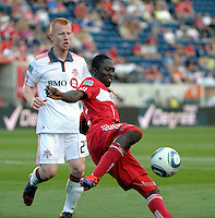 Chicago forward Patrick Nyarko (14) prepares to kick the ball as Toronto defender Richard Eckersley (27) approaches.  The Chicago Fire defeated Toronto FC 2-0 at Toyota Park in Bridgeview, IL on August 21, 2011.