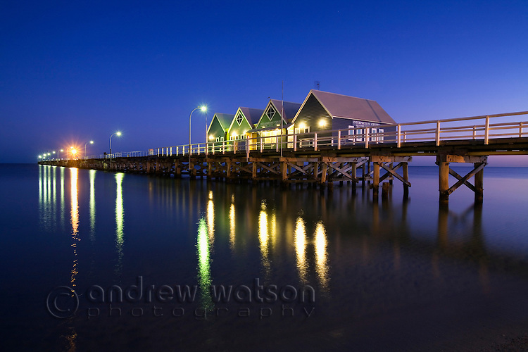 Busselton jetty at dawn.  Constructed in 1865, the structure is the longest timber jetty in the world at 2 kilometres long and houses a museum and underwater observatory.  Busselton, Geographe Bay, Western Australia, AUSTRALIA.