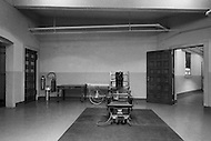 Osening, New York City, NY. November 1970. Electric chair In the room of Sing Sing Prison.  There was also a stretcher on the wheel to carry the body from the chair to the infirmery after the execution. The first part of the prison opened in 1828.