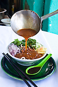 Penang's famous Asam Laksa is posed for a photo in Georgetown of Penang, Malaysia. Photo: Sanjit Das/Panos