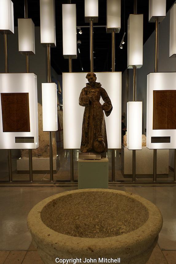 Catholic monk or friar sculplture,  Gran Museo del Mundo Maya museum in Merida, Yucatan, Mexico  .                           .
